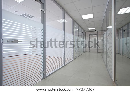 Empty office with glass walls and doors - stock photo