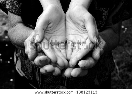 Empty old and young hands in black and white - stock photo