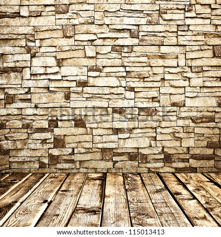 Empty old spacious room with stone grungy wall and wooden weathered dirty floor, vintage background texture of brickwall - stock photo