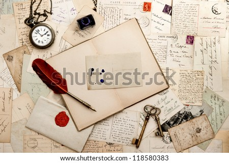 empty open book, old keys, clock and postcards. sentimental vintage background - stock photo