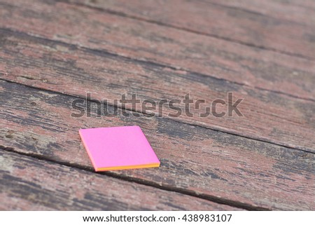 Empty or blank notepad on a vintage wooden board,Note patch on wood surface texture background,Sticky notes on old wood background. - stock photo