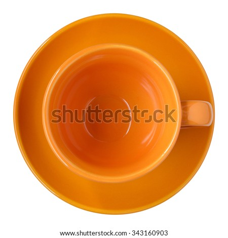 empty orange cup and saucer top view isolated on white - stock photo