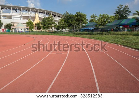 empty outdoor racetrack with blue sky - stock photo