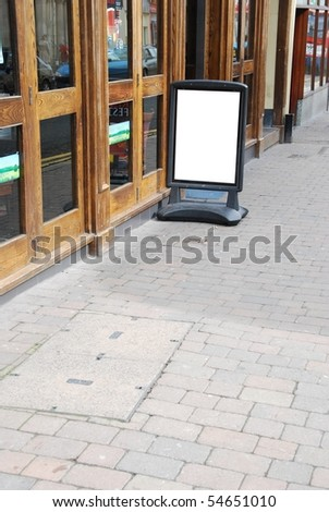 empty outdoor restaurant/pub menu in a british downtown street - stock photo