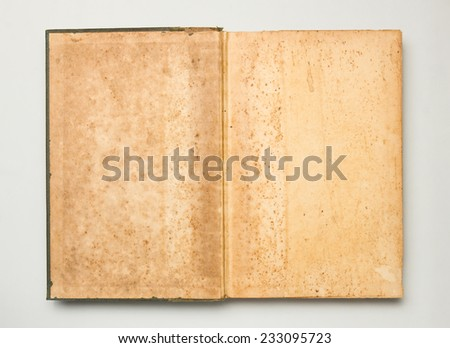 Empty page of vintage book with copy space on grey background.  - stock photo
