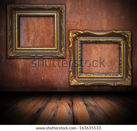 empty painting frames on rusted wall, interior architectural backdrop for your design - stock photo