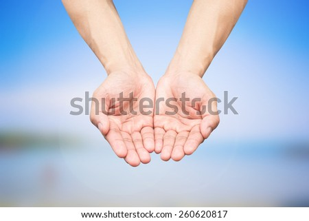 Empty palms up on blurred sea backgrounds,soft focused - stock photo