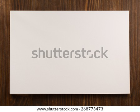 empty paper blank sheet on wooden background - stock photo