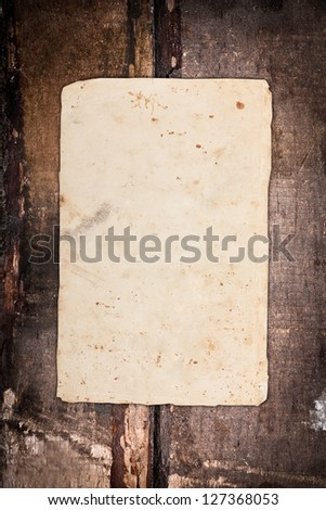 Empty paper sheet on wood - stock photo