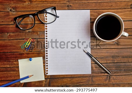 Empty paper with coffee and notes on desk - stock photo