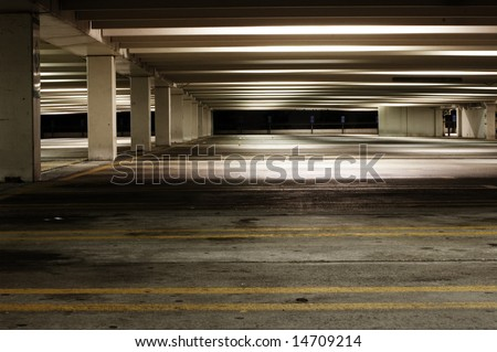 Empty parking garage at night, dirty and dark. - stock photo