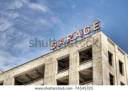 Empty parking garage structure with garage sign - stock photo
