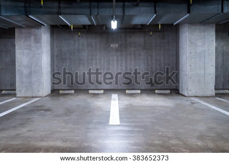 empty Parking garage underground, interior shopping mall at night - stock photo