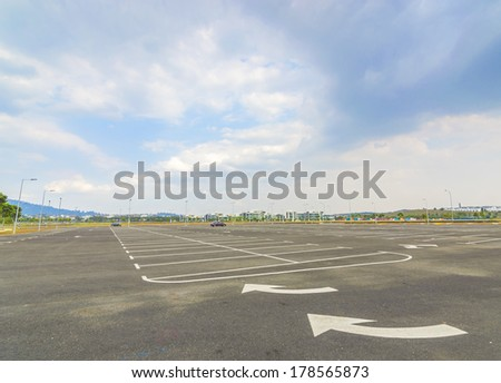 Empty parking lot with blue skies - stock photo
