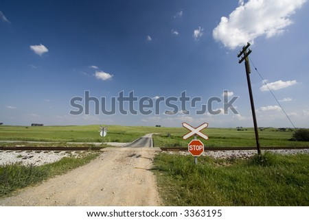 Empty path through Railway lines in a beautiful summer day - stock photo
