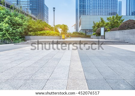 empty pavement and modern buildings in city - stock photo