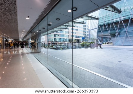 Empty pavement by the side of office building - stock photo