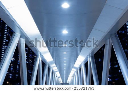 Empty pedestrian walkway over busy street  - stock photo