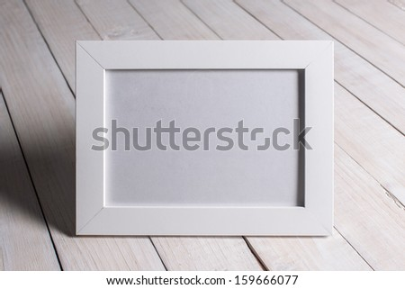 empty photo frame in woman hands - stock photo