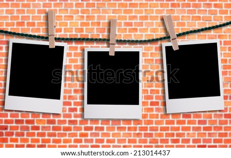 empty Photos on a clothesline in front of a wall / empty Photos - stock photo