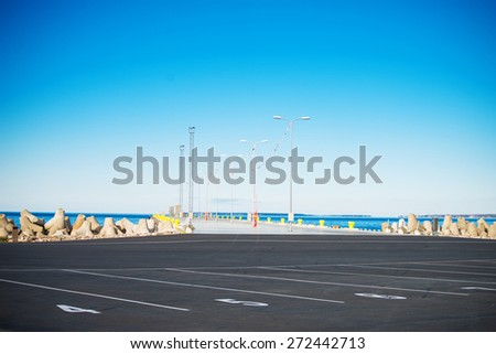 Empty pier for large ships. - stock photo