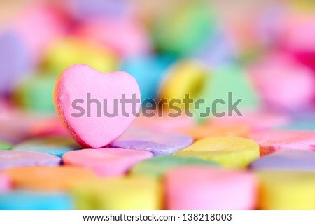 Empty pink heart candy over colorful bonbon - stock photo