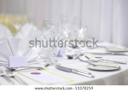 Empty place cards on the white festive table - stock photo