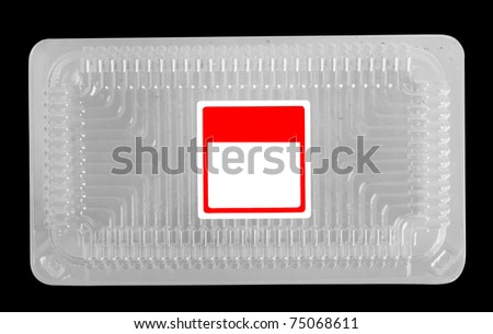 Empty plastic food tray with blank label. Isolated on black - stock photo