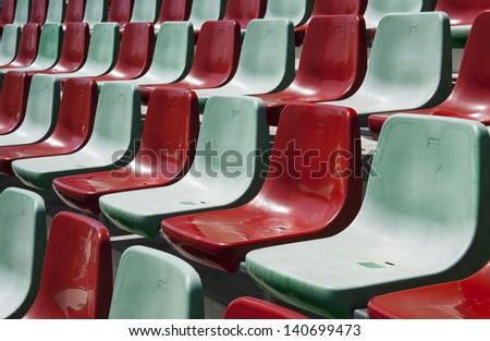 Empty plastic  stadium seats in a row - stock photo