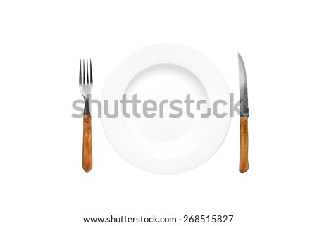 Empty plate old rustic fork and knife isolated over white background with clipping path - stock photo