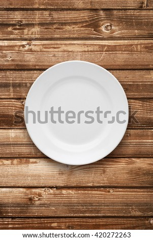 Empty plate top view on table - stock photo