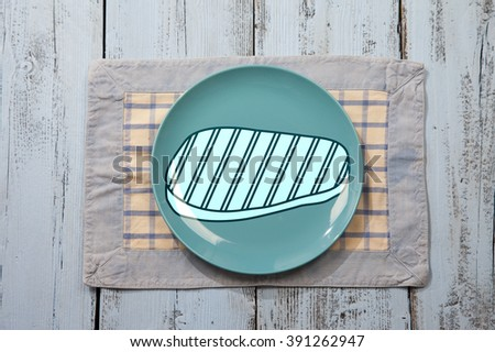 Empty plate with meat sign on light blue wooden background - stock photo