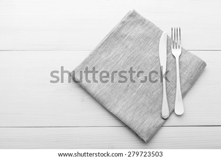 Empty plates and cutlery on table cloth on wooden table for dinner, menu in restaurant Top view horizontally. Flat mock up for design. - stock photo
