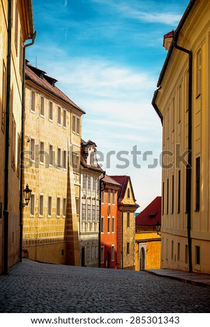 Empty Prague Street in Early Morning with Beautiful Old Facades and Blue Sky - stock photo