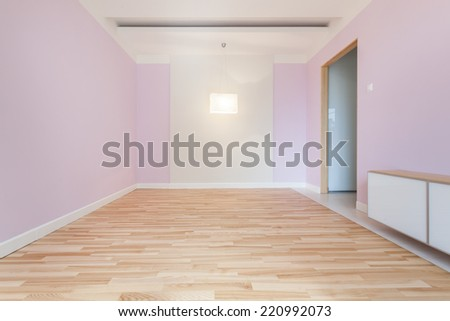 Empty purple room with new wood parquet - stock photo