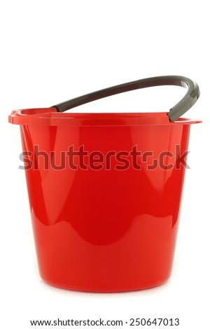 empty red plastic household bucket with a grey handle on a white background - stock photo