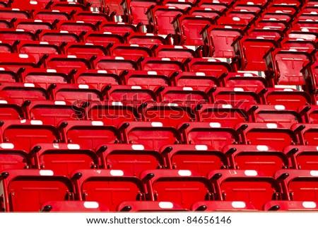 empty red stadium seats - stock photo