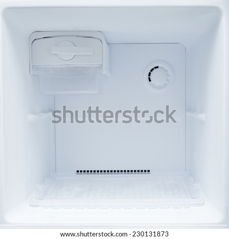 empty refrigerator freezer of kitchen appliance - stock photo