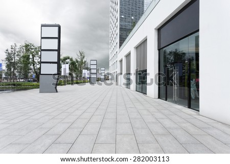 Empty road and building facade - stock photo