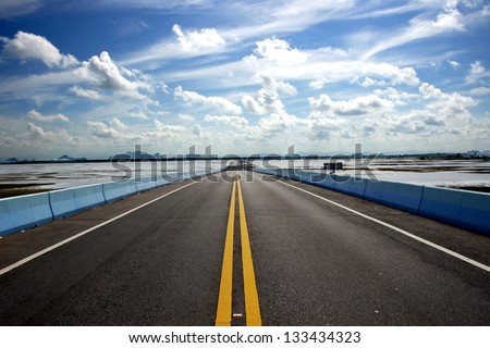 Empty road and the traffic lines. - stock photo