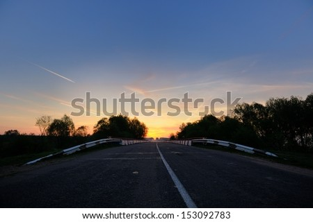 Empty Road Bridge at Sunrise - stock photo