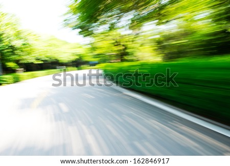 empty road in the jungle. motion blur - stock photo