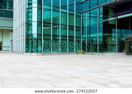 Empty road near modern building exterior - stock photo