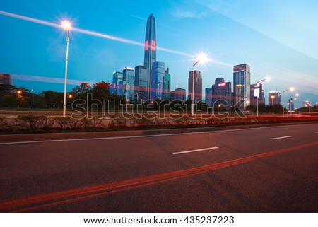 Empty road surface floor with modern city landmark building backgrounds of night scene in Shenzhen China - stock photo