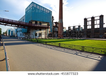 Empty road surface floor with old abandoned closed steel steelworks of pipelines - stock photo