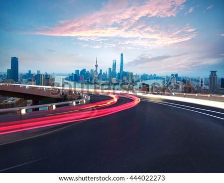 Empty road textured floor with Aerial photography bird-eye view at Shanghai bund Skyline of night scene  - stock photo