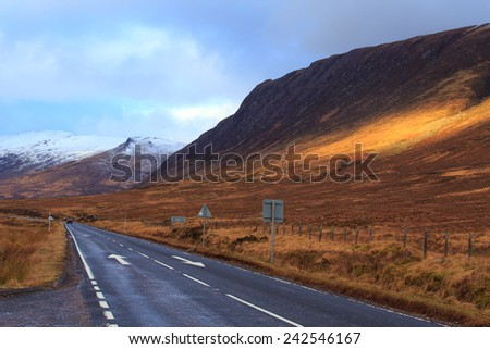 Empty road through Scotland - stock photo