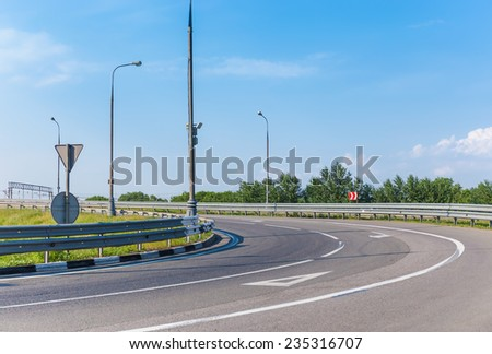 Empty road turn left to the road intersection - stock photo