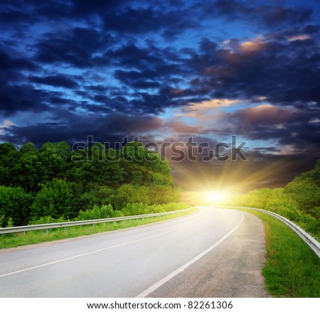 Empty road with cloudy sky and sunlight - stock photo