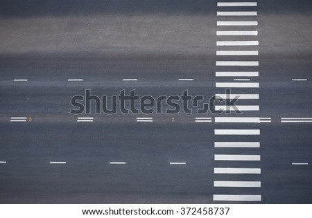 empty road with pedestrian crossing, top view - stock photo